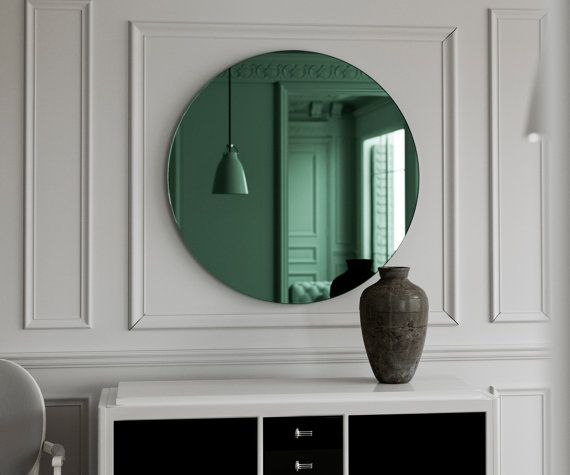 Round Green mirror. Frameless mirror with bright green glass mirror and…