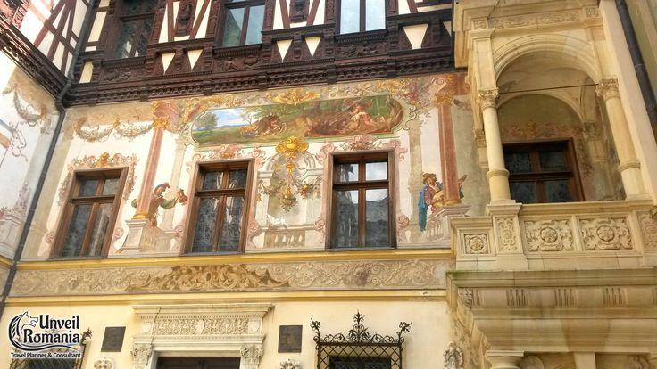 Peles Castle inner courtyard - allegorical hand-painted murals and german fachwerk #discoverRomania #traveltoRomania #Sinaia #PelesCastle #Transylvania