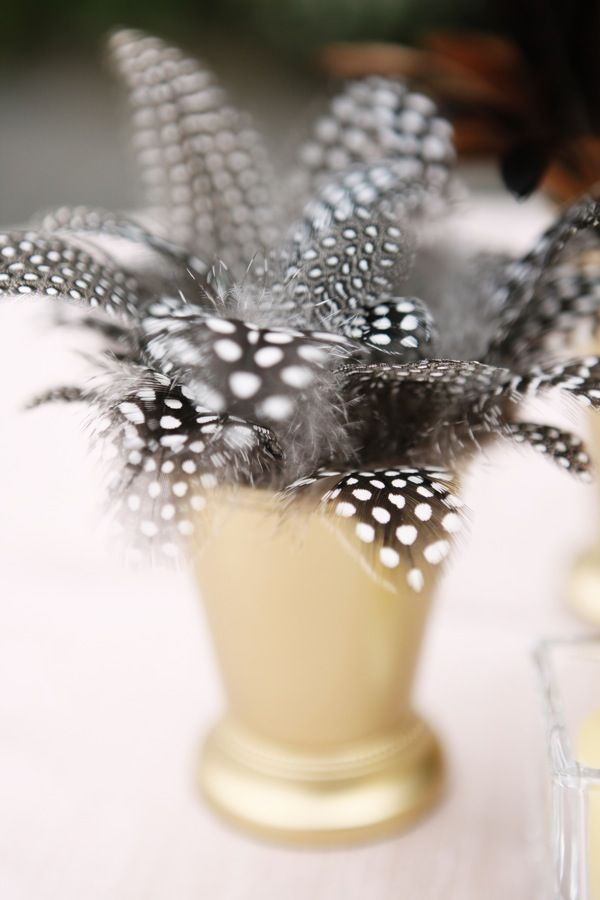 Feather decor! Could grab any color at a gatsby party at the dollar store.