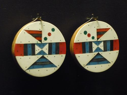 Zulu ear-discs c1950, Iziko South African Museum, Cape Town. See history here.