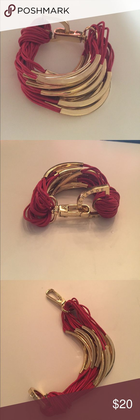 Armani Exchange Red and Gold Cuff Bracelet Armani Exchange multi-strand style cuff with cotton cord and metal links.  One size. Cotton cording and metal. A few scratches on the metal fastening clip but not really noticeable. Fun piece. A/X Armani Exchange Jewelry Bracelets