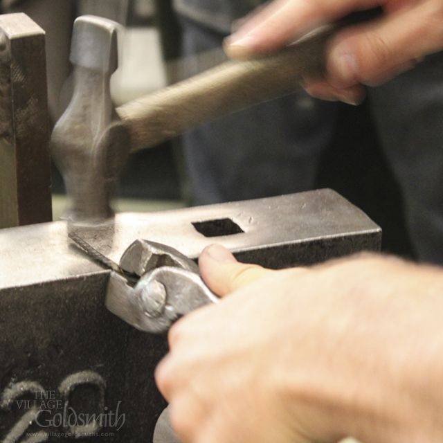 carefully twisting and hammering the metal to create a mokume gane ring