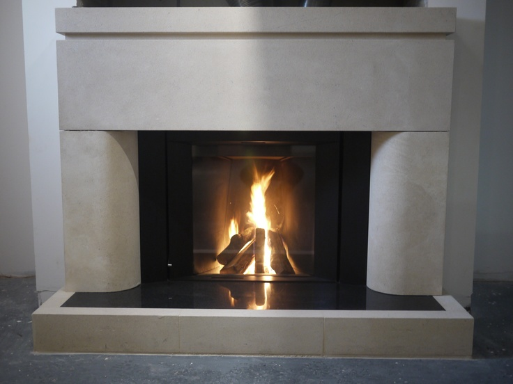 New Moderna Bath stone surround with Stuv wood burner