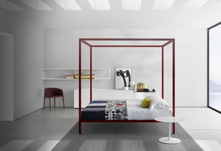 MDF Italia Aluminium bed in it's canopy version in a minimal bedroom.