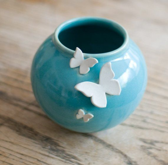 flying beauty- pinch pots with cookie cutter shapes