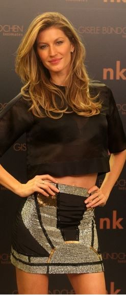 Who made  Gisele Bundchen's black short sleeve mesh top and beaded skirt?