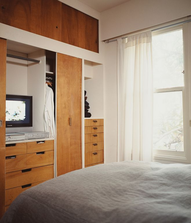 Mid-Century Mash-Up // Built-ins in the bedroom echo the cabinetry from the great room.  Photo by Misha Gravenor.