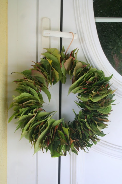 reuse your hanger, stick leaves through it and you'll get a wreath