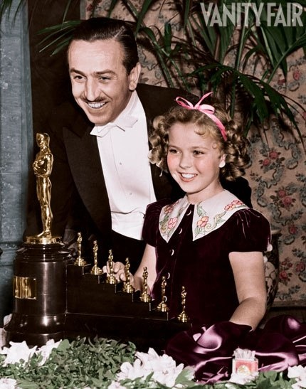 Shirley Temple and Walt Disney (with Walt Disney's special Oscar for Snow White and the Seven Dwarfs)