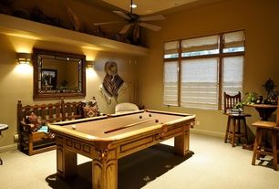 Southwestern Game Room with Ceiling fan, Pool table, Wall sconce, Carpet
