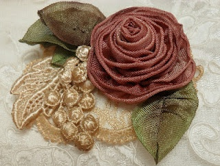A beautiful adornent for madame's chapeau or pinned to that special dress!  Lambs and Ivy Ribbonwork