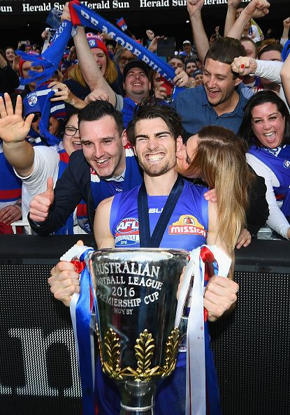 #AFLGF2016 Easton Wood of the Bulldogs celebrates with the trophy after winning the 2016 AFL Grand Final match between the Sydney Swans and the Western Bulldogs...
