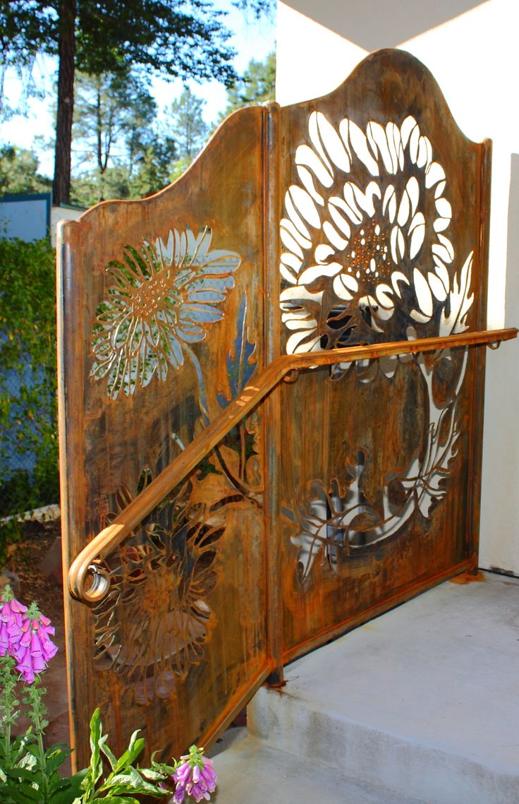 handrail with dividing screen utilizing a plasma cut chrysanthemum pattern, and rusted finish. 2011 by steven brock.