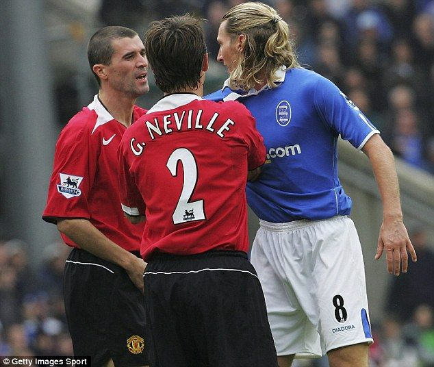 Keane and Neville wrestle with Birmingham's Robbie Savage.