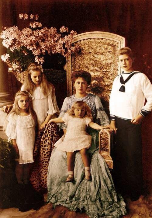 Queen Marie of Romania and her children.