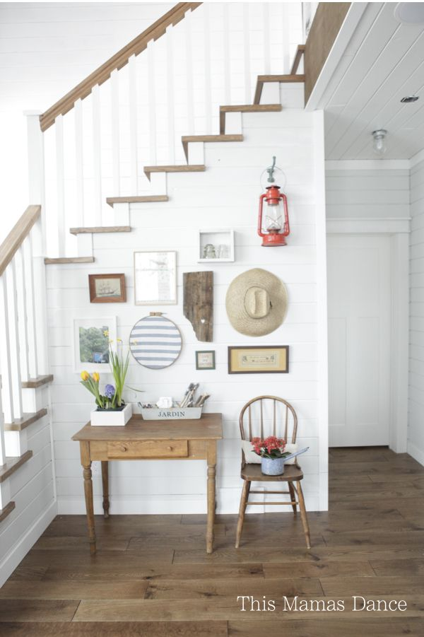 Farmhouse foyer gallery wall - love the mix of art and unique finds eclecticallyvintage.com