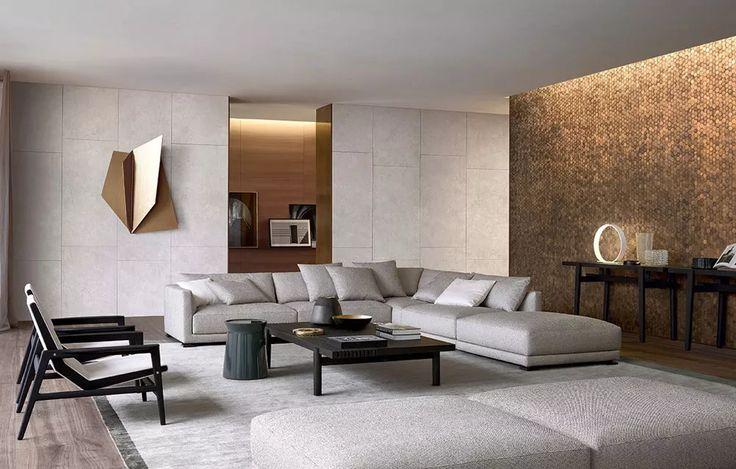 Salotto moderno particolare con una perfetta zona relax. Parete metallico in sintonia con la scultura a muro e arredamento colori neutri