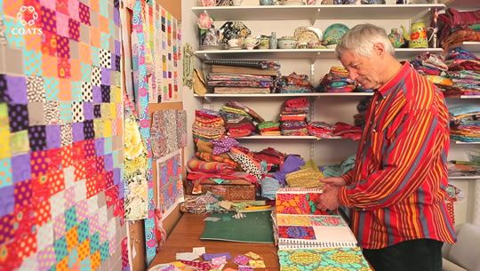 Kaffe Fassett on Quilting with Bright Squares quilt on the design wall. This is one class I am taking at the Missouri Star Quilt Company retreat in November.