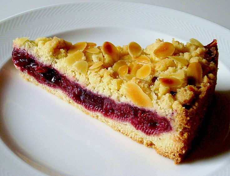 Authentic German Cherry Streusel Cake recipe from Germany, proven and very easy to make. The recipe is using sour cherries. You will love this cake.