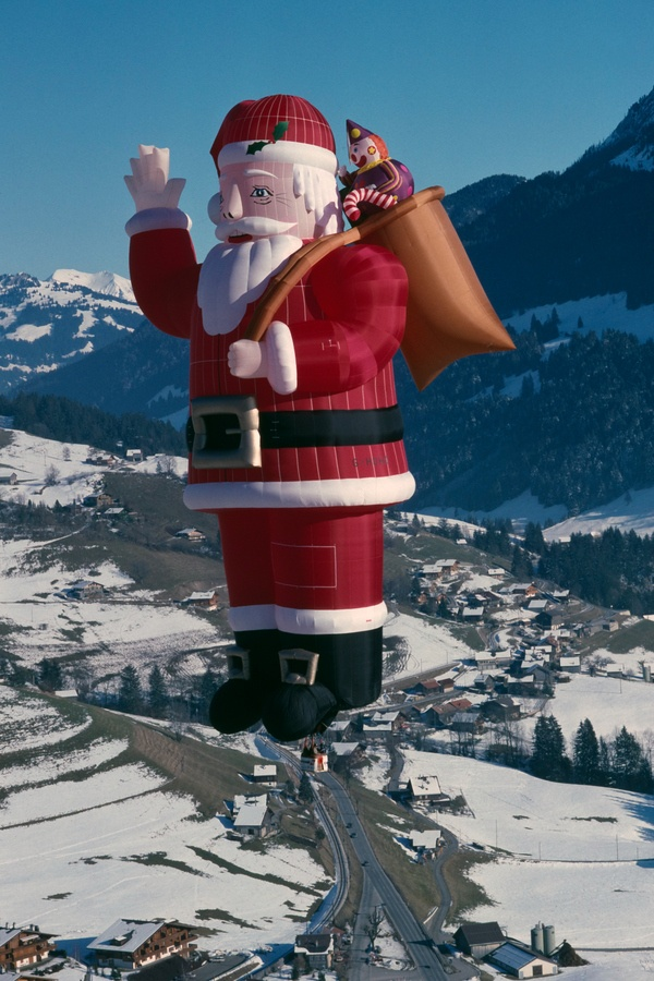 Santa Claus Special Shape (G-HOHO) flying in Chateaux-d'Oex in the Swiss Alps