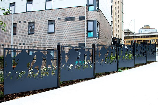 Grace & Webb's laser cut panels as public art at the St Marys student accommodation Southampton, inspired by the nearby football ground