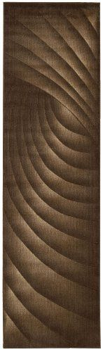 Nourison Zanibar Solid Wave Chocolate 2.3-Feet by 8-Feet Polyacrylic Runner Rug by Nourison. $73.94. Densely woven, strikingly luxurious pile; traditional style. Dry clean recommended. Rug pad recommended. Machine woven in China. Power loomed in China; 50% polypropylene, 50% acrylic. 100% Polyacrylic. In this distinctive collection, premium quality Opulon yarns are used to create a densely woven and strikingly luxurious pile. The fashion appeal of the color palette is warm...