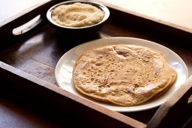 sweet paratha or whole wheat flat bread stuffed with sugar - crisp, caramelized and too good. can also be made with powdered jaggery, palm sugar or coconut sugar.
