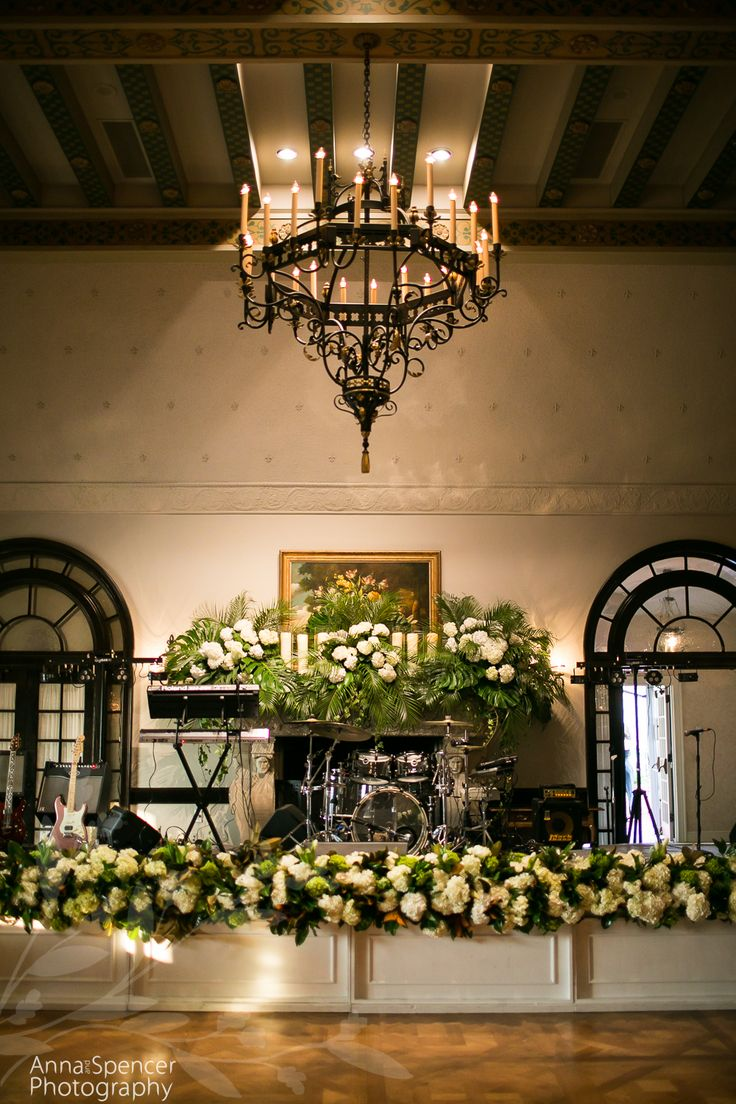 White Hydrangea Flowers With Magnolia Leaves And Tropical Greenery Garland Decorating The Band