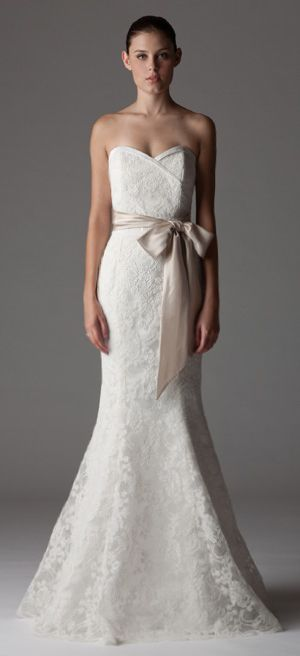 Style 275. Strapless wedding dress with surplice neckline with built-in waistband. www.ariadress.com