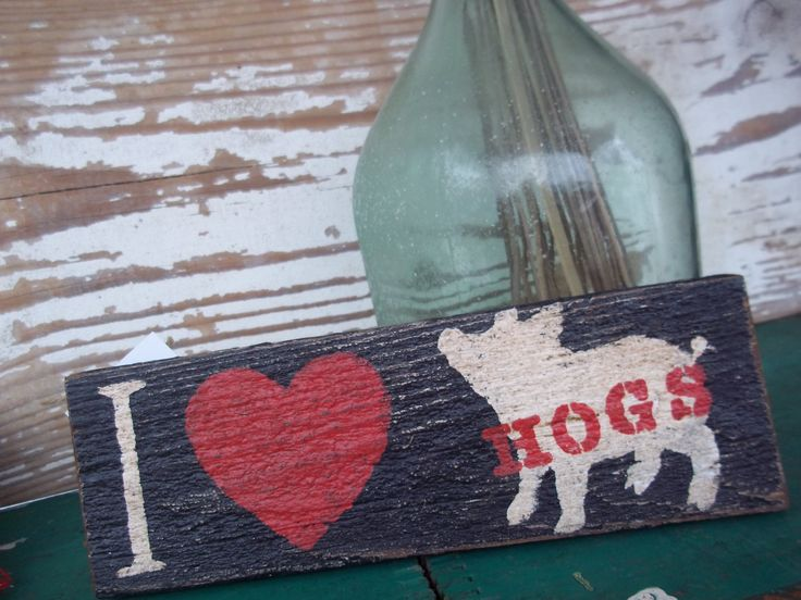 Arkansas Razorback Hogs Salvaged Wood Hand painted Sign I Love Hogs by BohoCoast on Etsy https://www.etsy.com/listing/158568546/arkansas-razorback-hogs-salvaged-wood