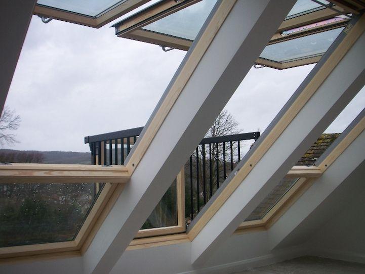 Amazing skylight window that transforms into a balcony