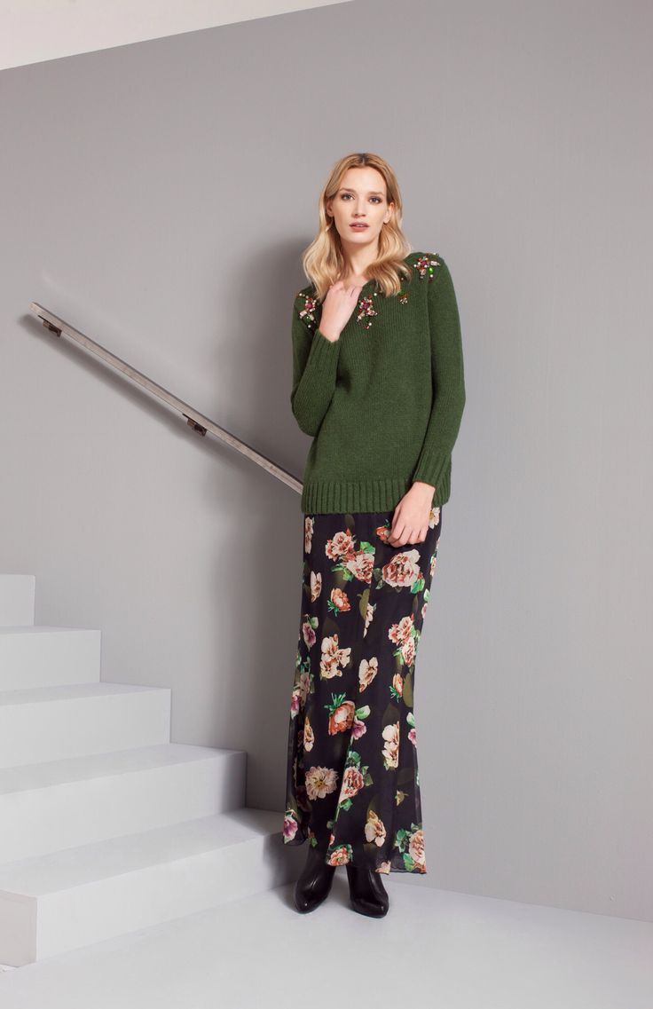 There is always something warm and soft in the cold rainy day. For example, this dark green wool pullover decorated with particular crystal stones. Discover Maria Grazia Severi fall/winter collection with us.
