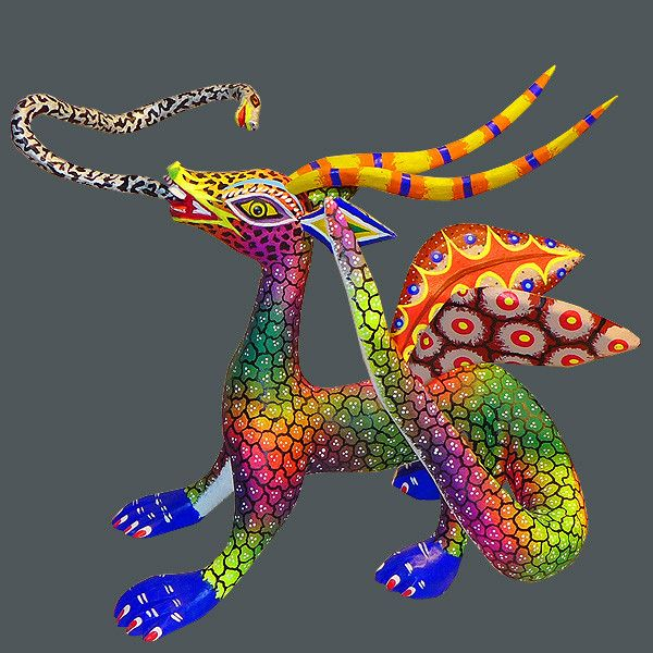 Dragons are the motif where Oaxacan artists express their signature originality from the depths of their dreams. Marco Garcia's flying dragon has a menacing snake tongue, fire tinged horns, and multi-