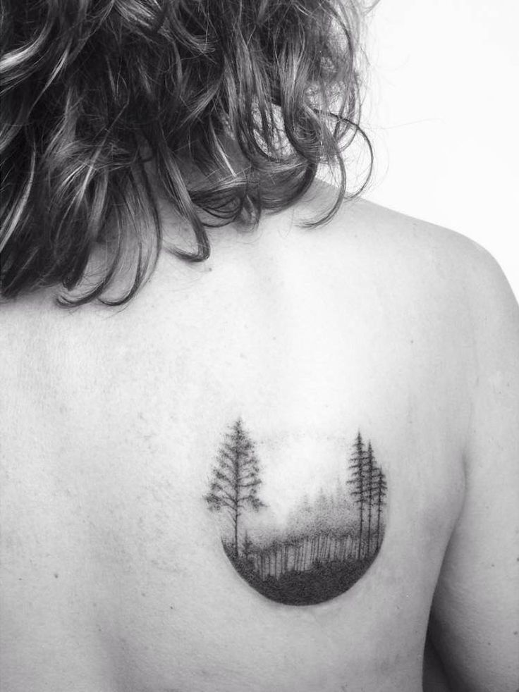 Hand poked forest circle tattoo on the right shoulder blade. Tattoo Artist: Lara M. J.