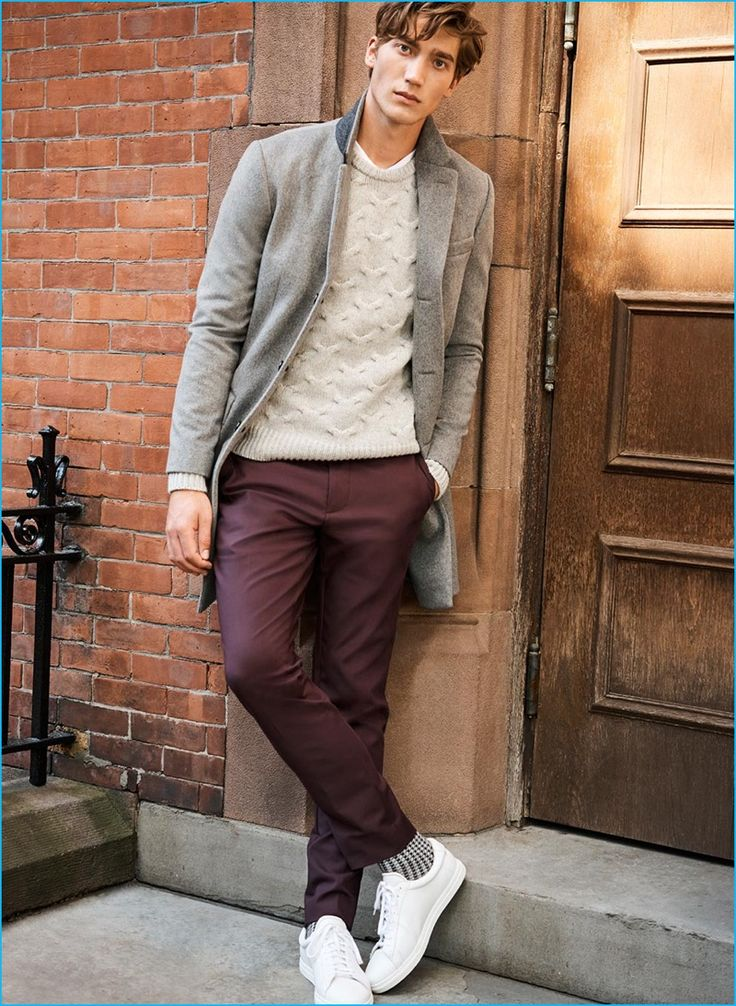 Going for a smart casual look from Club Monaco, Jeff Ryan wears a wool-cashmere topcoat, cable-knit sweater, burgundy modern stretch trousers and Zespas sneakers.