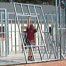 STEEL FRAME KIT HOMES We supply a riveted, hi-tensile steel frame.  The frame comes in easy to handle sections for single-handed bolt together assembly.  Roof trusses are assembled on site in two halves for easy handling and lifting.