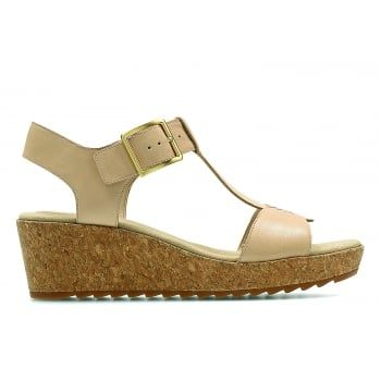 Offering everyday style and comfort, the Clarks Women's Kamara Kiki Sandals boast a luxurious cushioned footbed and chic t-bar strap design with wedge heel. An elegant buckle fastening and full leather uppers provide a charming finish to a lightweight, casual sandal. http://www.marshallshoes.co.uk/womens-c2/clarks-womens-kamara-kiki-nude-leather-t-bar-sandals-p4587