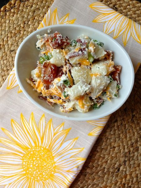 Loaded Baked Potato Salad    Servings/Yield: 10-12 servings  3-lb. bag red potatoes  1-1½ cups sour cream, (reduced fat is fine)  ½-¾ cup mayonnaise, (light is fine)  1-2 packages ranch seasoning mix  1 ½ cups grated sharp cheddar cheese  5 green onions, chopped  10-12-oz. package thick-cut bacon, cooked & crumbled