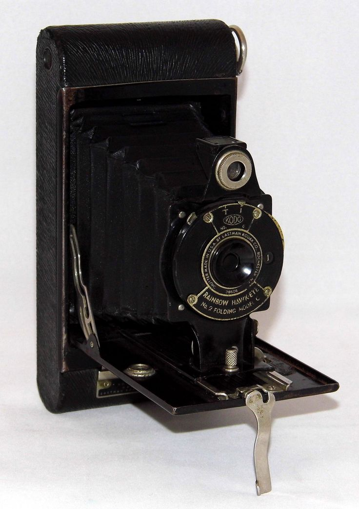 https://flic.kr/p/VmQaBE | Vintage Kodak Rainbow Hawk-Eye Folding Camera, No. 2 Model C, Made In USA, Circa 1930 | From a 1930 newspaper ad for the Kodak Rainbow camera -- Well-named are these new Rainbow Hawk-Eyes - bright, cheerful Eastman-made cameras that come in coverings as subtly tinted as the rainbow itself. Vermillion to blue, light green to dark maroon-whatever your favorite shade may be, you'll find it here in a Rainbow Hawk-Eye.  Of course, the Rainbow Hawk-Eye also came in black…
