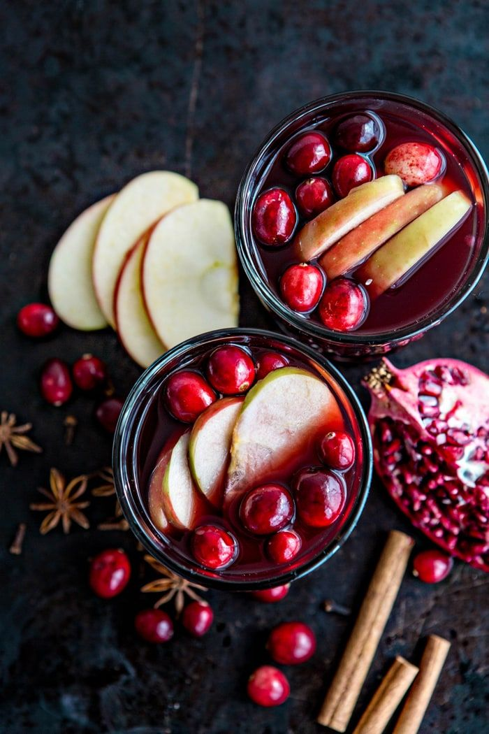 Spiced Pomegranate Apple Cider Mulled Wine Sangria recipe and photo fall cocktail - this would be a great cocktail for Thanksgiving. Fresh pressed apple cider, tart pomegranate juice, and Tempranillo pair with mulling spices and fresh fruit to create a fall-inspired cocktail, perfect for sipping during this autumn and winter season.