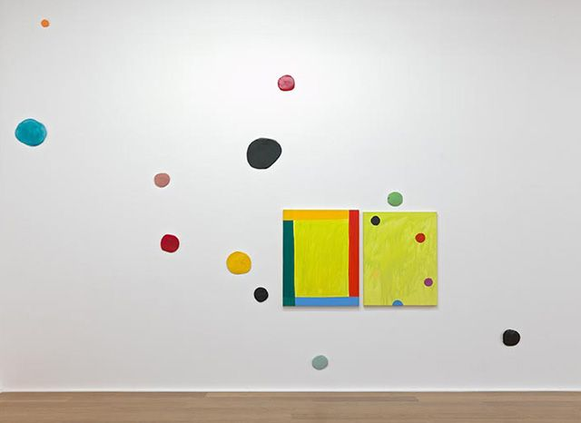 "Mary Heilmann, ""Good Vibrations Diptych, Remembering David"" (2012). Oil on canvas and 11 glazed ceramic dots, painting diptych 40 x 60 inches – installation size variable:"