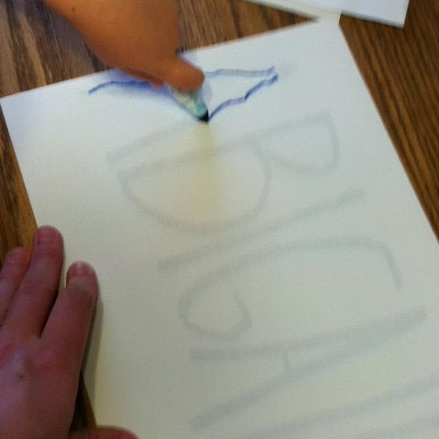 Name writing You write your child's name in paper in bold marker. Then place a plain white paper over top. Abs loves TRACING her name!!