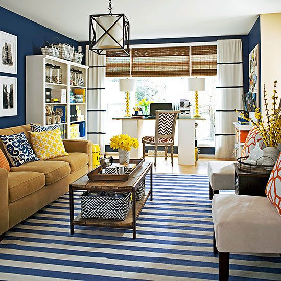 Select Smart Furniture - This hardworking living room stands at just under 200 square feet yet it still incorporates distinct zones for family gatherings and business. This is possible with savvy furniture that doubles as storage, such as a coffee table that holds baskets on a lower shelf.