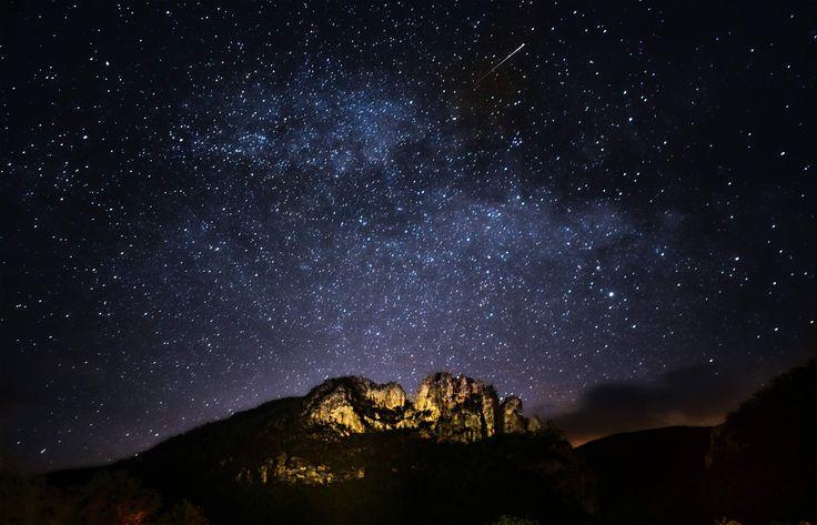 A meteor streaks across the sky over Seneca Rocks in the ...