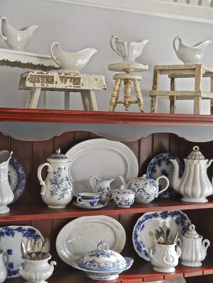 Love the little stools on top of the hutch.  from Chateau Chic: Let's Talk About Ironstone--unique ways to display pieces