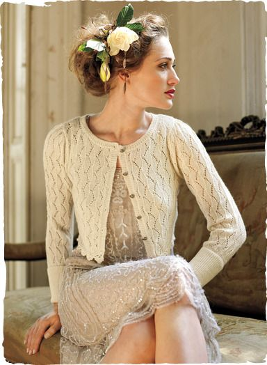 Versatile enough to go from day to night, our airy lace cardigan is stylishly cropped to 15-1/2'' in length and edged in crocheted scallops. Knit of baby alpaca; in Ivory, Black or Charcoal.