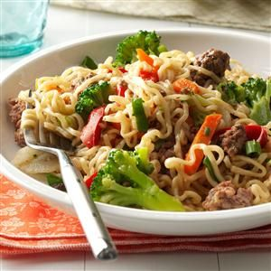 Asian Beef and Noodles Recipe -This colorful, economical stir-fry dish takes only five ingredients—all of which you're likely to have on hand. Serve with a dash of soy sauce and a side of pineapple slices. Or try ground turkey instead of beef! —Laura Stenberg, Wyoming, Minnesota