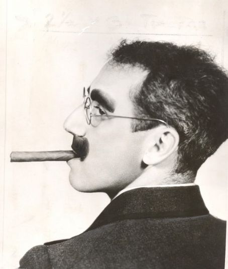 Groucho Marx. Vaudeville actor. Comedian. Master of wit known for delivering rapid one-line zingers, many of which have been immortalized. His signature cigar, greasepaint mustache, thick glasses, thick eyebrows and slouched posture have influenced novelty items and made him the most famous Marx brother.