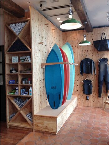 Surf shop with plywood peg wall for modular display solutions.