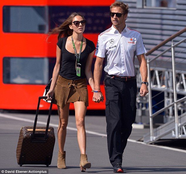 Jessica Michibata looked on-trend in a suede miniskirt and matching boots as she walked hand-in-hand with Jenson Button at the German Grand Prix